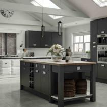 Flat door kitchen, large island, mantle and range.
