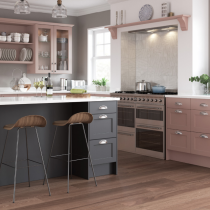 Shaker style kitchen, glass doors, plate rack, island with seating.