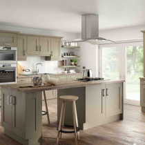 Shaker style kitchen, island with hob and feature ceiling extractor.