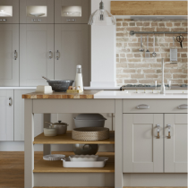 Shaker style kitchen, large island with storage, units to the ceiling.