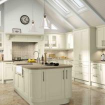 Shaker style kitchen, large island, sink on island.