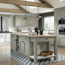 Shaker style kitchen with large island, range and mantle feature.