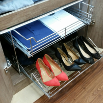 Wardrobe two tier pull out for shoes and clothing.
