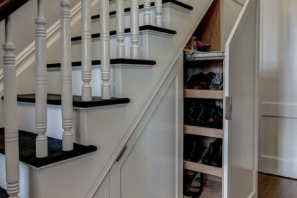 Under the stairs, cabinets & shelving to make the most of this space